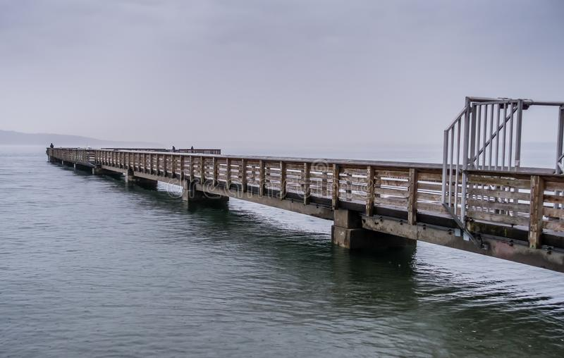 Pier On Rainy Day 9. A view of the pier at Dash Point, Washington on a rainy day stock photo