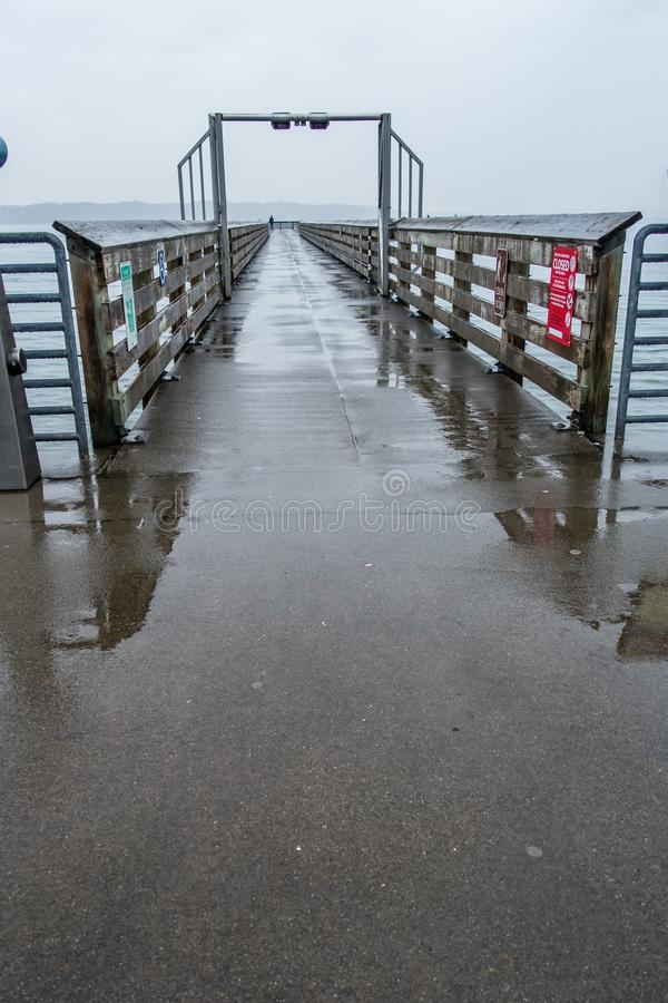 Pier On Rainy Day 8. A view of the pier at Dash Point, Washington on a rainy day royalty free stock images