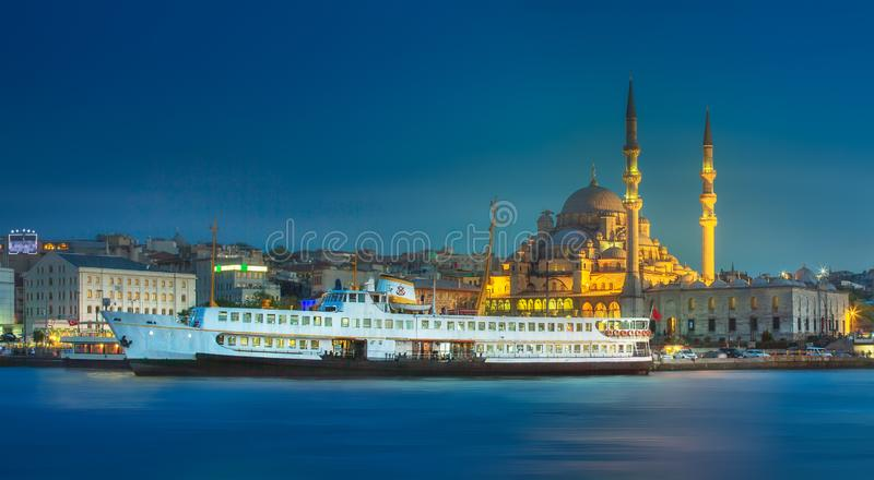 View of public ferry and old district of Istanbul. View of pier, public ferry and old district of Istanbul with Mosque on skyline, Turkey royalty free stock images