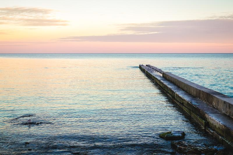 View of the pier during sunset. At the beach royalty free stock image