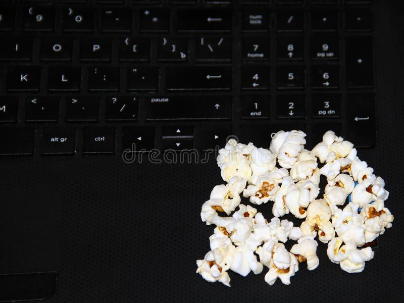 Top view of a pile of popcorn caramel popcorn in a plate on a glass table stock photography