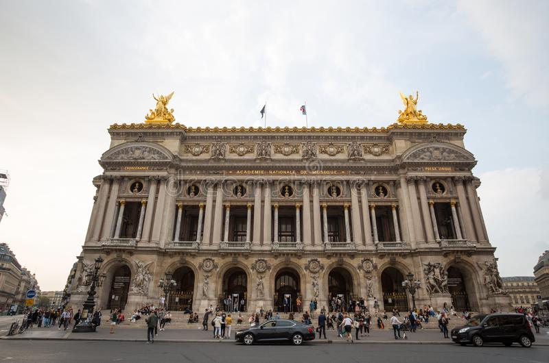 View of Place de l`Opera and Opera de Paris building. Grand Opera Garnier Palace is famous neo-baroque building in Paris, France.  royalty free stock photography
