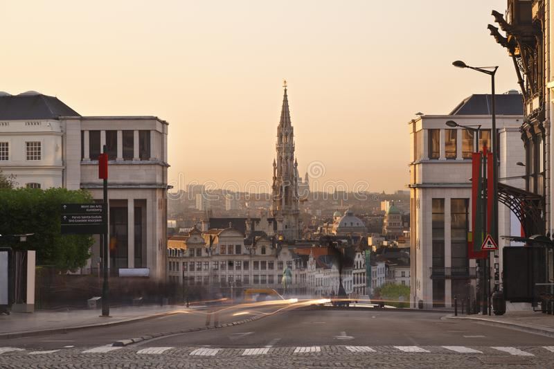 Place Royale In Brussels, Belgium. View from Place Royale to Grand Place with the tall tower of the Hotel De Ville. Long exposure shot with warm evening light stock images