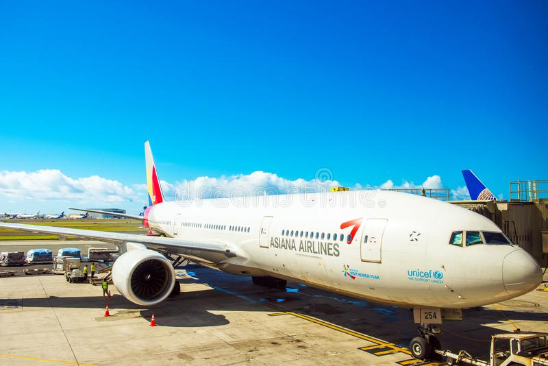 HONOLULU, HAWAII - FEBRUARY 16, 2018: View of the plane at the airport. Copy space for text stock photography