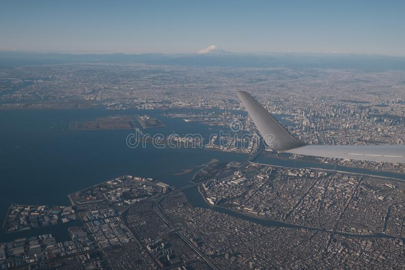 View from a plane departing Tokyo with Mt. Fuji in the background stock images