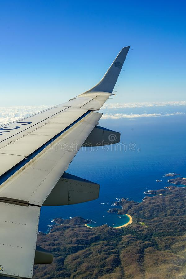 View from the plane on Huatulco Bay, Mexico. Preserved nature, quiet sand beaches, birdwatching, all for nature lovers at Huatulco Bay, Mexico royalty free stock image
