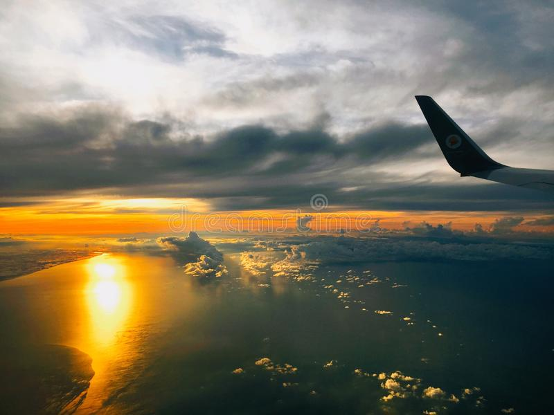 View on the plane with the sky and sunset at sea stock photo
