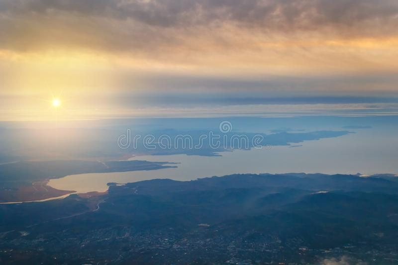 View from the plane to the island of Sakhalin, the mountains and the sea with the seaport. stock images