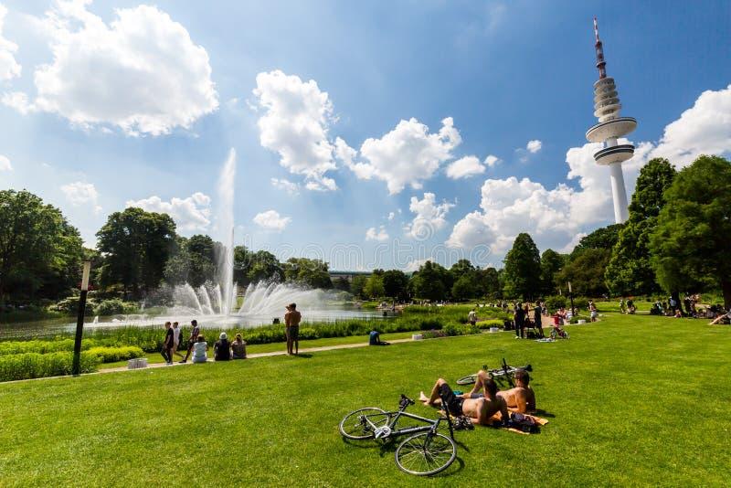 View of the Planten un Blomen Park near the Parksee. HAMBURG, GERMANY - JUNE 5, 2016: View of the Planten un Blomen Park near the Parksee on June 5, 2016. The royalty free stock photography