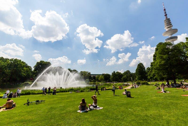 View of the Planten un Blomen Park near the Parksee. HAMBURG, GERMANY - JUNE 5, 2016: View of the Planten un Blomen Park near the Parksee on June 5, 2016. The stock photos