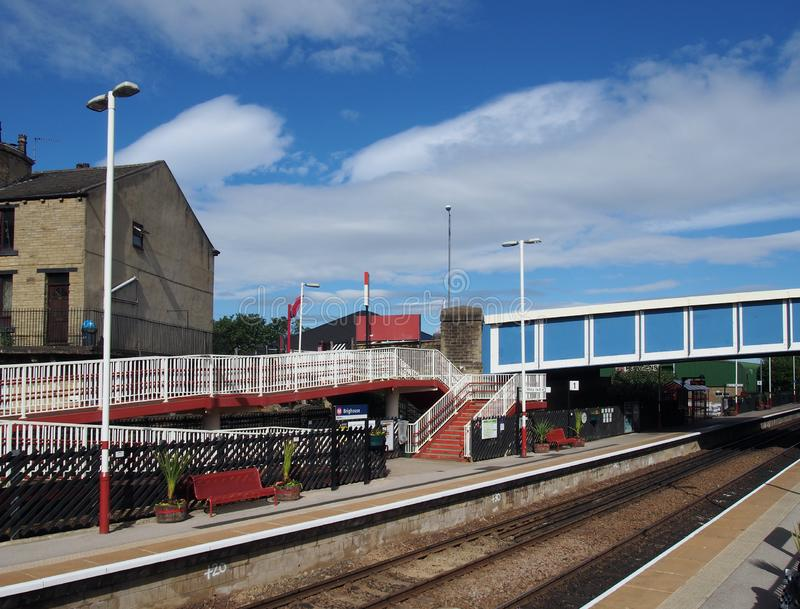 A view of the platforms and footbridge of brighouse railway station in calderdale west yorkshire taken from the road above. Brighouse, west yorkshire, united royalty free stock photography