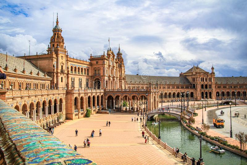 View of the Plaza de Espana at Seville in the foreground of the colorful balustrade of the building stock photography