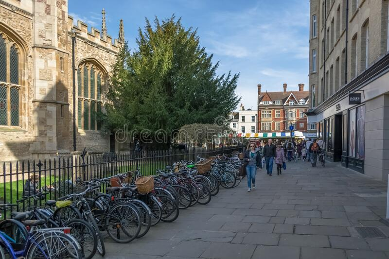 View at the Plaza Kings Parade street on Cambridge downtown, Great St Marys Church and Senate house passage building, bikes. Cambridge, England / United Kingdom royalty free stock images