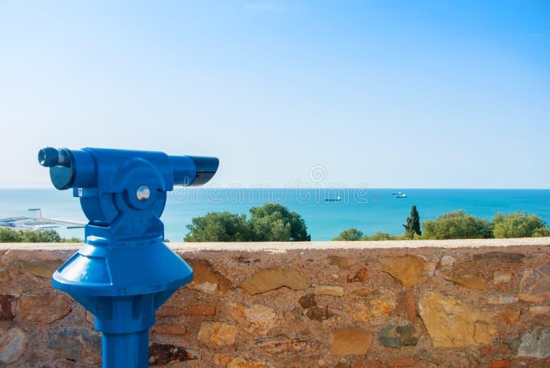 View point at Malaga fortress Alcazaba, a blue coin telescope stock photo