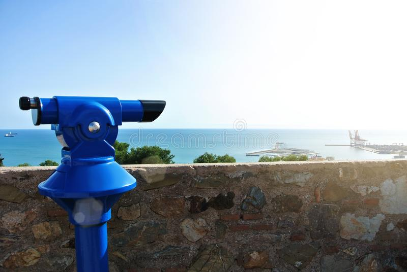 View point at Malaga fortress Alcazaba, a blue coin telescope stock images