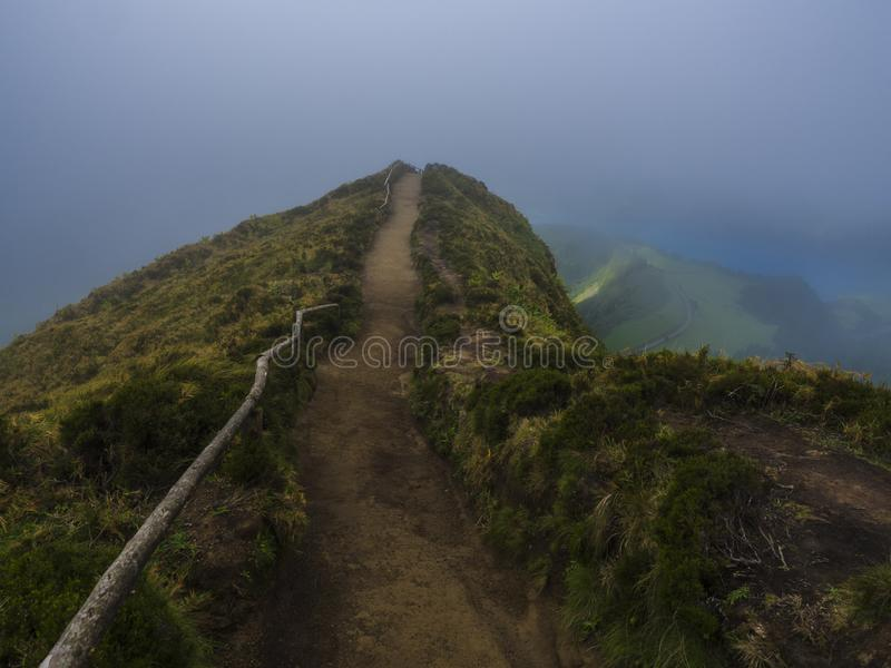 View point Miradouro da Boca do Inferno overlooking the lakes of Sete Cidades, lakes covered by fog mist and clouds. Sao royalty free stock photography
