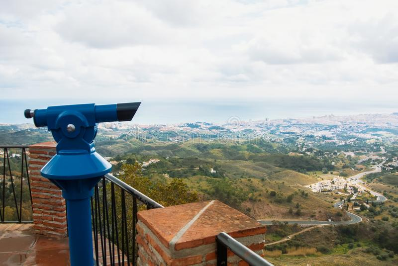 View point in the park of Mijas, a blue coin telescope and a beautiful panoramic aerial view to Mediterranean sea and a road to F stock images