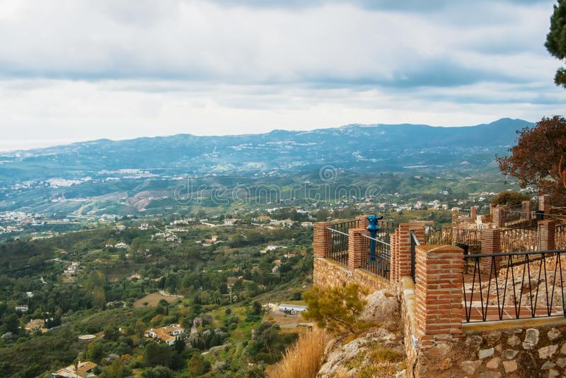View point in the park of Mijas, a blue coin telescope and a beautiful panoramic aerial view to Mediterranean sea and surrounding royalty free stock image