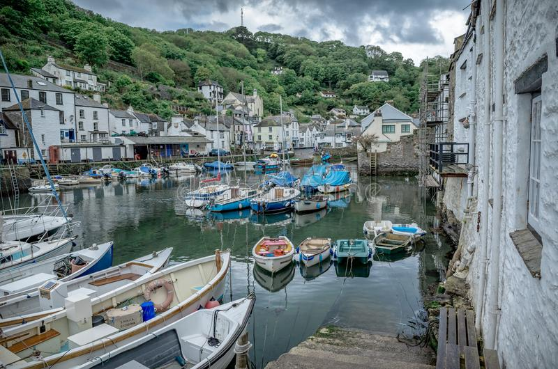 View of Polperro harbour in Cornwall. Boats in Polperro harbour in Cornwall on a summer day stock photography