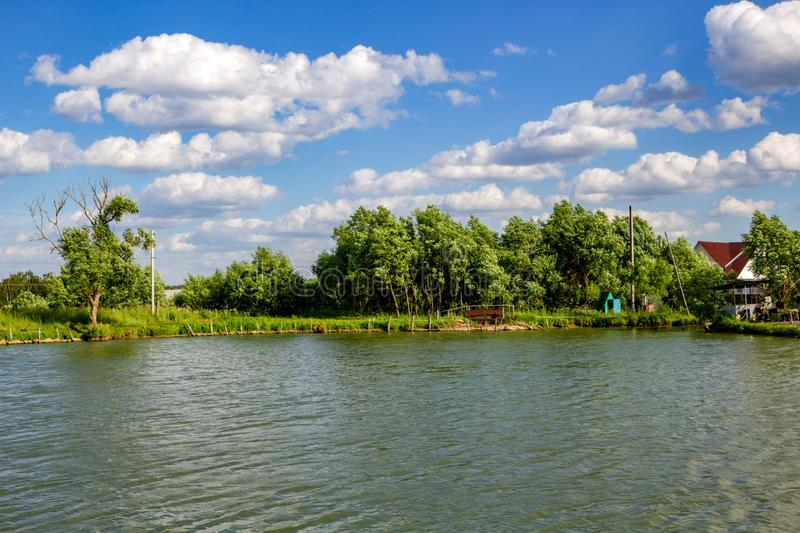 View of the ponds in the village Uvarovskoe summer bright day. Russia royalty free stock photo