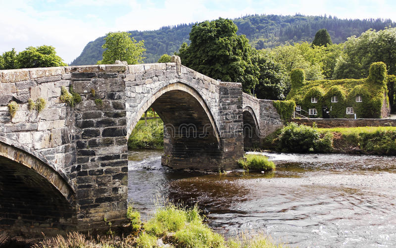 A View of Pont Fawr and Tu Hwnt I'r Bont. LLANRWST, WALES, JUNE 27. Pont Fawr Bridge and Tu Hwnt I'r Bont Tearoom on June 27, 2016, in Llanrwst, Wales stock photo