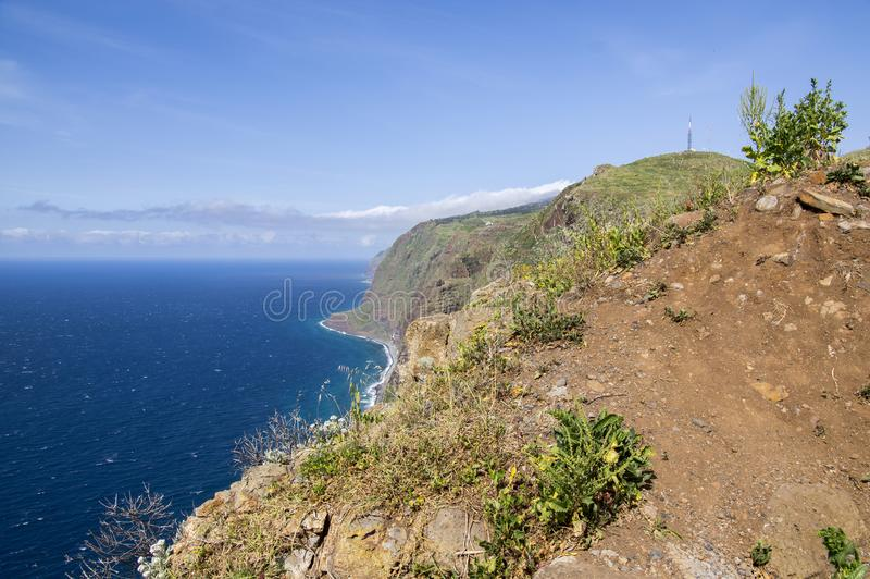 View from Ponta do Pargo view point, view over the cliff, amazing wild nature greenery, blue deep Atlantic ocean, Madeira island royalty free stock photography
