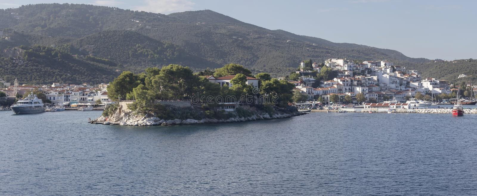 View of the port of the island Skiathos Northern Sporades, Greece. Panoramic view of the port of Skiathos Northern Sporades, Greece, mountains and the sea from a royalty free stock image