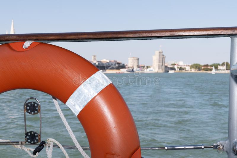View of the port of La Rochelle from a boat with an orange buoy. A view of the port of La Rochelle from a boat with an orange buoy royalty free stock photography