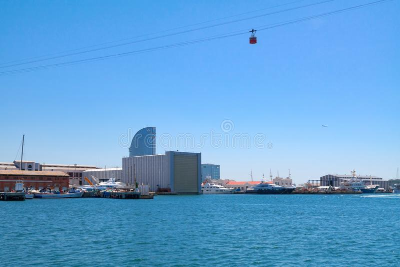 View from the Port Vell on harbor with cable car over it and Hotel W Barcelona in the background - May 2 2016, Barcelona, Spain stock images