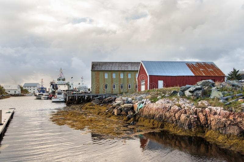 View of the port of the village of Dyrnes at Smola island, Norway. Dyrnes, Smola, Norway - August 30th, 2018: View of the port of the village of Dyrnes at Smola stock photo