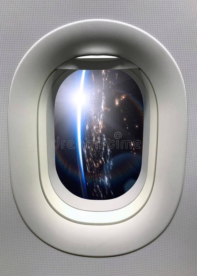 View from a porthole on the night Earth planet. Elements of this image furnished by NASA.  royalty free stock photo