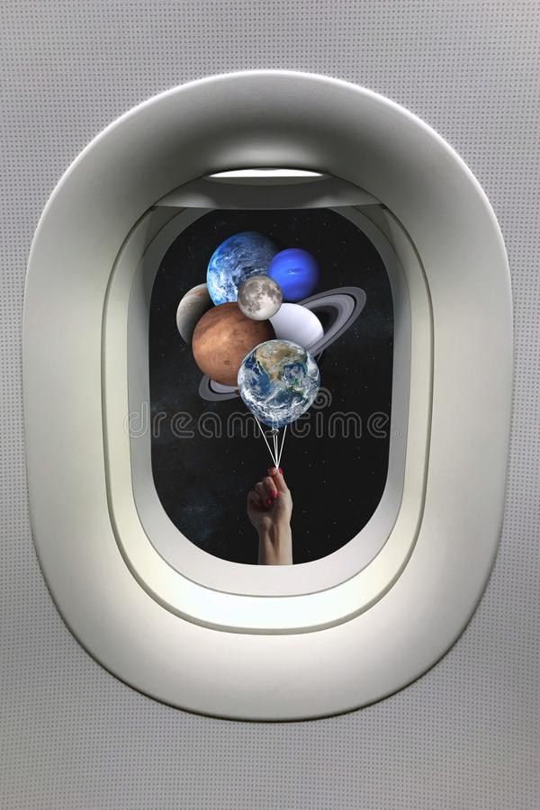 View from porthole window on hand with planets shaped balloons in solar system. Elements of this image furnished by NASA.  stock photo