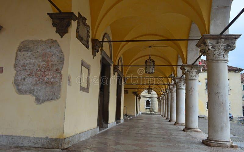View of the porticoes - Palazzo dei Rettori Belluno Italy. View under the arches of  Palazzo dei Rettori Belluno Veneto Italy royalty free stock photos