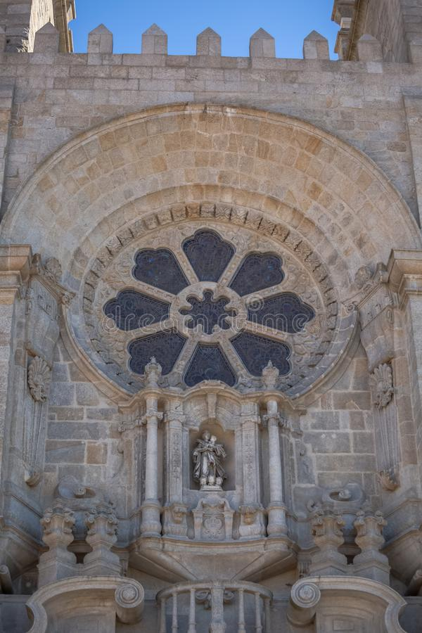 View at the Porto Cathedral facade, Sé do Porto, detailed ornamented rosacea window royalty free stock photography