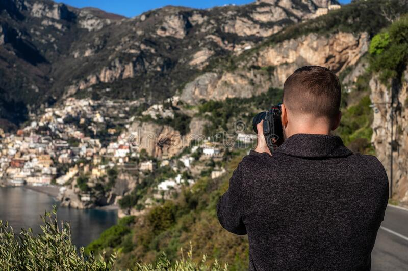 Man taking picture of Positano town, Italy stock photos