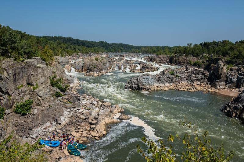 Rafting on Great Falls State Park, Virginia. View of the Potomac River from Great Falls State Park in Virginia, United States of America. People are rafting the royalty free stock images