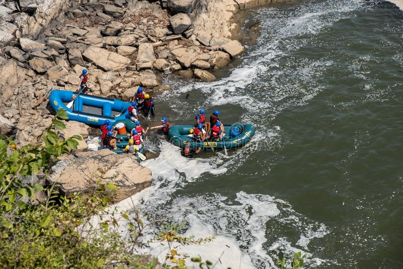 Rafting on Great Falls State Park, Virginia. View of the Potomac River from Great Falls State Park in Virginia, United States of America. People are rafting the royalty free stock image