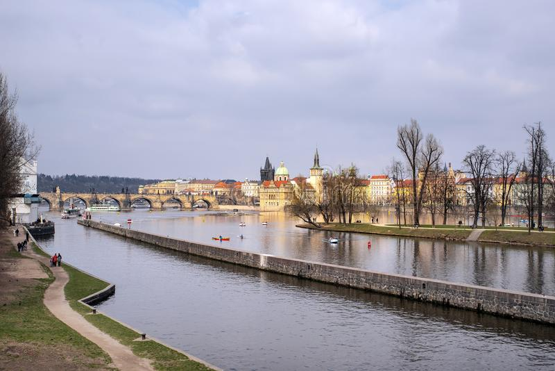 "View on a Prague and River Vltava. Prague, capital city of the Czech Republic, is bisected by the Vltava River. Nicknamed ""the City of a Hundred Spires stock photo"