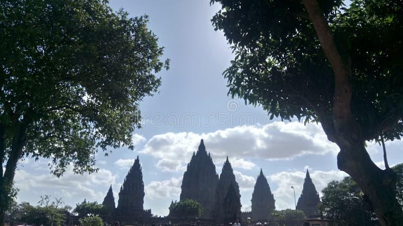 Prambanan tample. View prambanan tample between the trees royalty free stock images