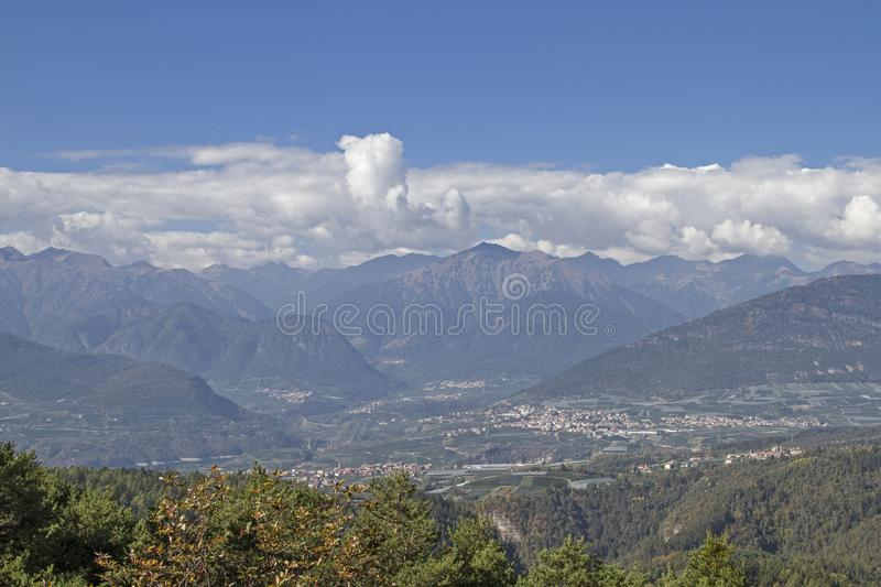 View over the Val di Non. View from the Predaia plateau in the Val di Non to the mighty mountain range of the Brenta group royalty free stock images