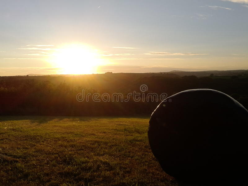 View of the preseli mountains at dusk with hay bal stock images