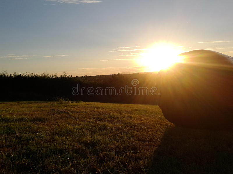 View of the preseli mountains at dusk with hay bal stock photo