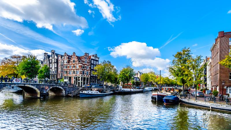 Tthe Prinsengracht canal in Amsterdam in the Netherlands. View of the Prinsengracht canal from the Papiermolensluis bridge in the city center of Amsterdam in the stock images