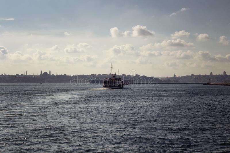 View of public ferry boat, Bosphorus strait. And European side of Istanbul in a sunny summer day royalty free stock photography