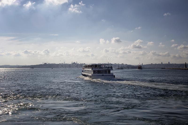 View of public ferry boat, Bosphorus strait. And European side of Istanbul in a sunny summer day stock photography