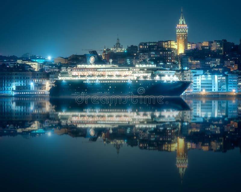 View of public ferry and old district of Istanbul. View of pier, public ferry and old district of Istanbul with Mosque on skyline at night, Turkey royalty free stock images