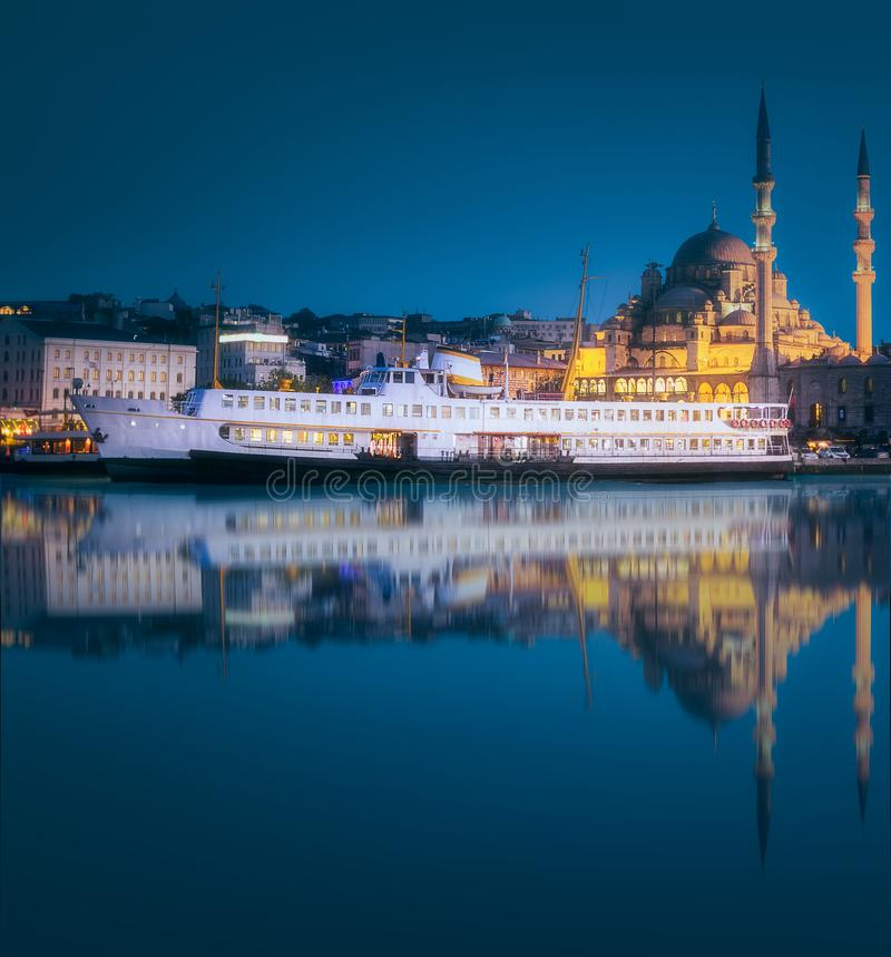 View of public ferry and old district of Istanbul. View of pier, public ferry and old district of Istanbul with reflection on water, Turkey. Clipping path of sky stock photos