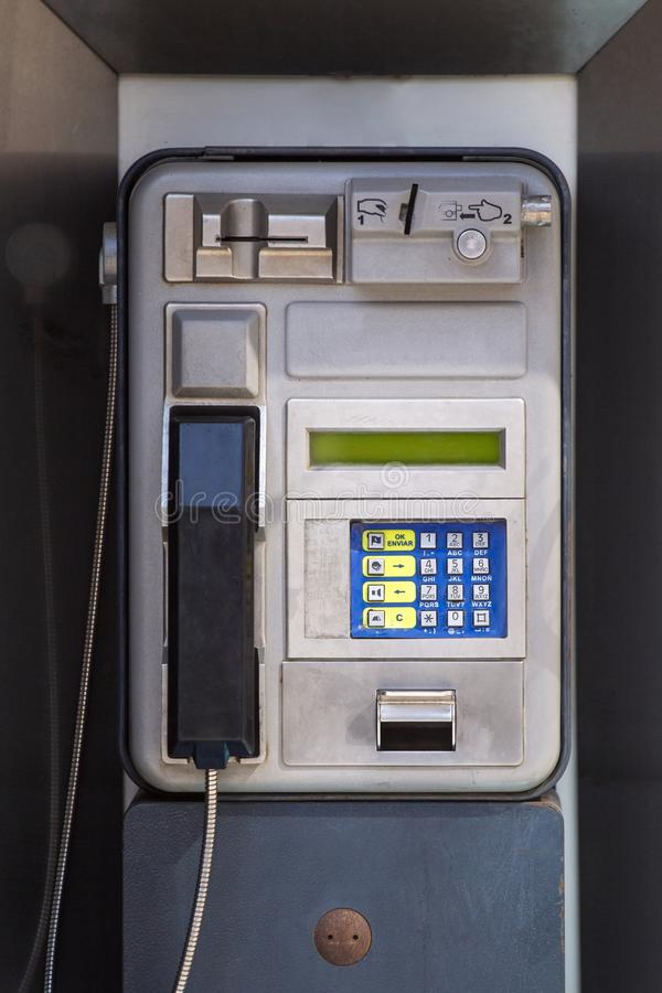 Public street phone. View of a public street phone from the 90s located in Spain, Europe royalty free stock image