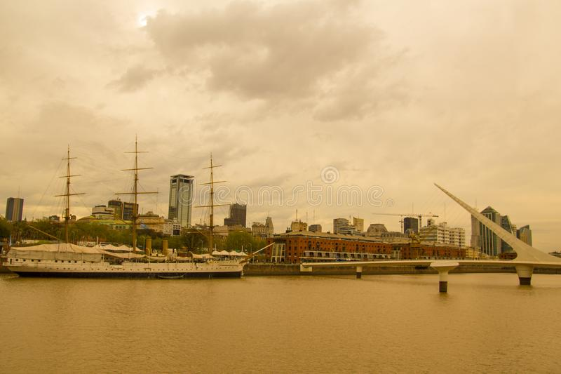 View of Puerto Madero, with the frigate Sarmiento and the Puente de la mujer. Puerto Madero, the old port of the city, now royalty free stock photo