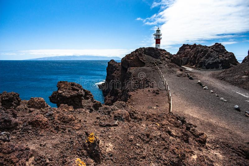 View of Punta de Teno lighthouse with La Gomera island in the background royalty free stock image